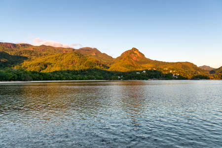 morne: Attractive Mahe Island Seascape with Morne Seychellois View, Emphasizing Tranquility. Captured at Early Morning in Beautiful Seychelles. Stock Photo