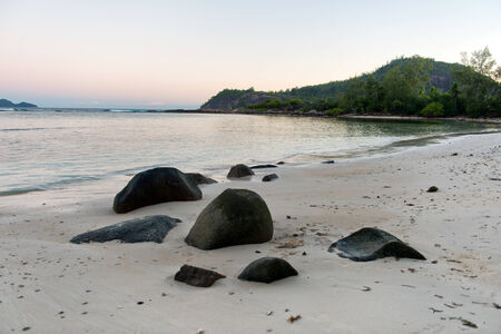 Tranquil Beach with Morne Blanc Mountain View Afar. Located at Mahe Island, Seychelles. photo