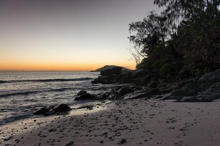 Small Size Stones at the Seashore of Mahe Island, Seychelles. Captured During Sunrise Time. photo
