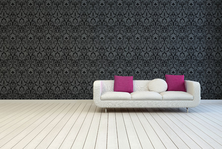 Single White Couch with White and Red Violet Pillows on an Empty Architectural Room with Artistic Black Floral Pattern Wall Design and Wooden Floor. photo
