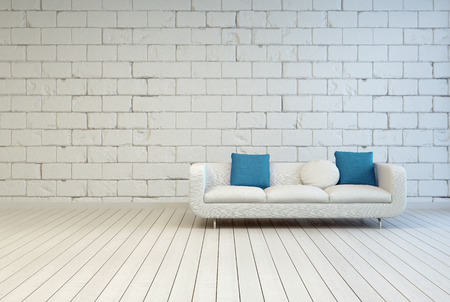 Elegant White Couch with White and Blue Green Pillows on an Empty Room with Seamless White Block Pattern Wall Design and Wooden Floor.