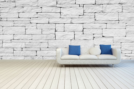 White Couch with White and Blue Pillows on an Architectural Room with Seamless White Stone Pattern Wall and Wooden Floor Design. photo