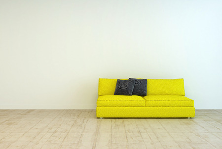 Yellow Couch Furniture with Black Pillows on an Empty Living Room with Off White Wall Background and Wooden Floor Design. Stock Photo