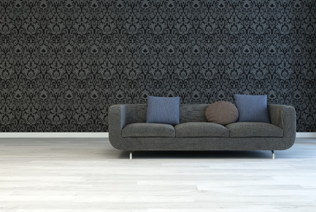 Dark Gray Sofa with Square and Round Pillows on an Architectural Lounge Room with Artistic Black Floral Pattern Wall and Off White Wooden Floor. photo