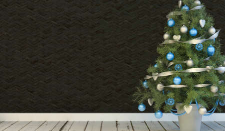 Christmas tree background with a green fir tree decorated with garlands and baubles on a rustic wooden floor against a black wall with copyspace for your festive seasonal greeting photo