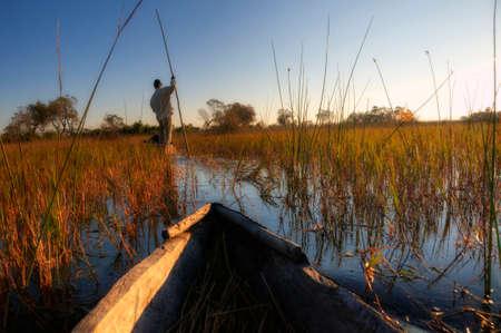 Fisherman at a river photo