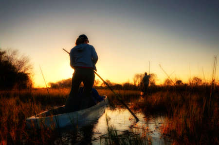 rowing: Fishermen rowing a boat