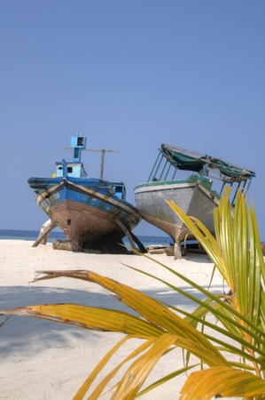 dilapidated: Dilapidated boats left on shore in Maldive Islands Stock Photo