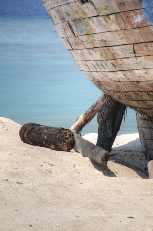 drydock: Dilapidated boat left on shore in Maldive Islands Stock Photo