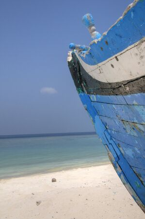 drydock: Dilapidated boats left on shore in Maldive Islands Stock Photo
