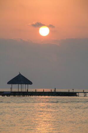 Sunset of jetty in Maldive Islands photo