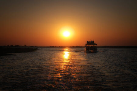 chobe national park: Boat trip in Chobe National Park during sunset, Botswana, Africa Stock Photo