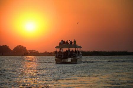 botswana: Boat trip in Chobe National Park during sunset, Botswana, Africa Stock Photo