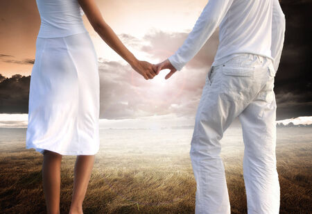 and holding hands: Low section of couple holding hands