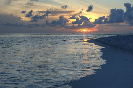 Panorama of beach in sunset, Maldive Islands photo