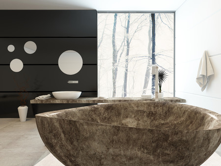 corner tub: Modern freestanding marbled bathtub in an elegant upmarket bathroom with a black accent wall anf floor-to-ceiling window with a view of winter trees