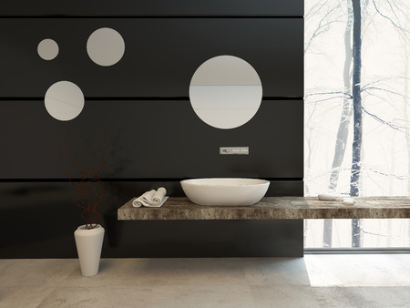 contemporary interior: Modern bathroom decor on a black wall with a wall-mounted hand basin below a round mirror over a beige tiled floor with a large view window letting in daylight