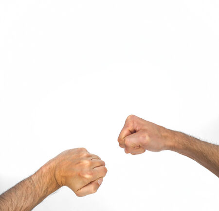 close fist: Two orientations of a man clenching his fist, one sideways and one viewed from overhead with a bent wrist, close up view of the arm isolated on white Stock Photo