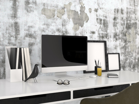 architectural studies: Workstation with a modern desktop computer spectacles, blank picture frames, a bird ornament and neat files against a grey wall with abstract pattern in a business, study or home office