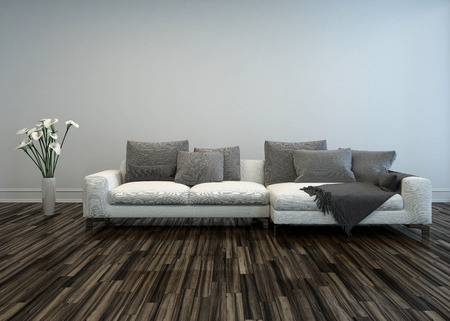 uncarpeted: White Sofa with Grey Cushions and Flower Vase of Lilies in Room with Hardwood Floor