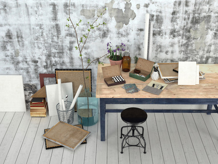 uncarpeted: Interior of an artist or designer studio with blank canvasses, picture frames and supplies on a simple black wood work table with a stool against an abstract patterned grey wall Stock Photo