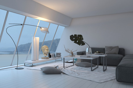 angled view: Modern white spacious living room interior with panoramic sloped windows overlooking the view furnished with a comfortable grey lounge suite illuminated with lamps Stock Photo