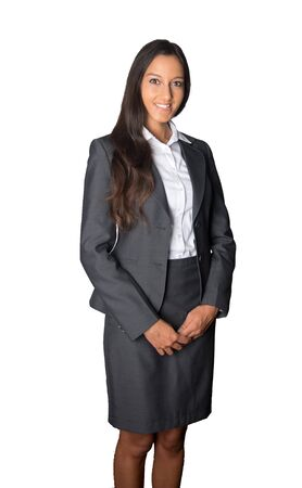 uniform attire: Attractive stylish friendly businesswoman with a pleased smile standing with her hands clasped in front of her looking at the camera, isolated on white