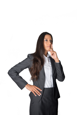 Pensive innovative intelligent young businesswoman staring into the air as she thinks through new ideas and plans a strategy, isolated on white