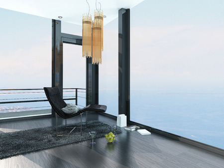 balcony design: Single modern recliner chair in the corner of a living room in a luxury seafront property interior with ocean view and floor-to-ceiling panoramic surround windows
