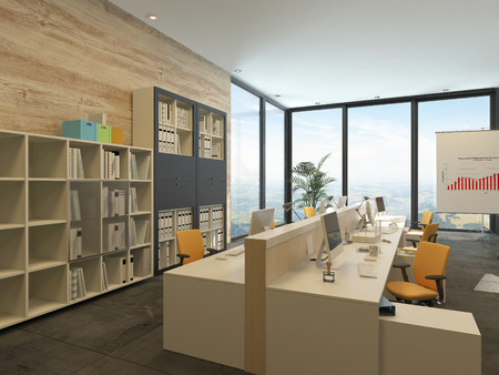 commercial: Modern open-plan office with multiple workstations in a spacious room with floor-to-ceiling windows and bookcases with files along one wall Stock Photo