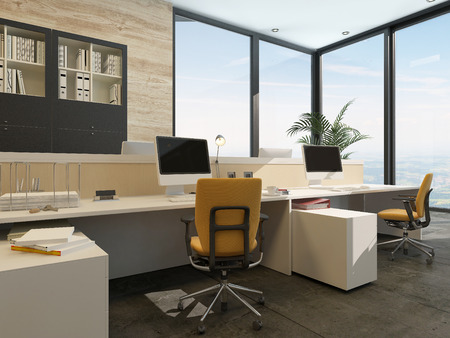 Spacious work environment in a modern office with work stations at a long table overlooked by a large glass window with views of the sky