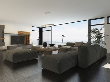 flat screen tv: Modern living room interior with grey and white decor and a large upholstered lounge suite around a flat screen TV in front of panoramic view windows