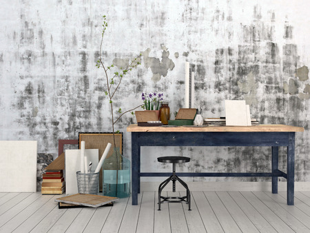 artists': Interior of an artist or designer studio with blank canvasses, picture frames and supplies on a simple black wood work table with a stool against an abstract patterned grey wall Stock Photo