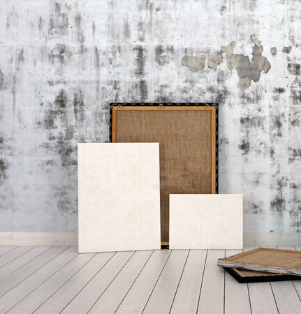 Frames and Boards Emphasizing Copy Space, Leaning on Unfinished Concrete Wall Inside an Empty Room with White Flooring. photo