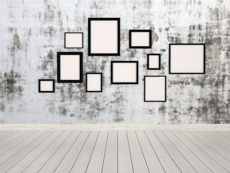 hanging on: Group of empty simple rectangular picture frames in different sizes hanging on a wall with an abstract mottled grey pattern conceptual of a gallery, exhibit or museum Stock Photo