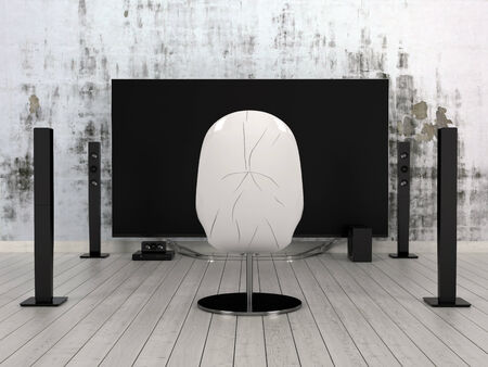 home cinema: Single modern molded white chair standing on a bare parquet floor between two symmetrical black poles facing a large flat screen television against an abstract grey wall Stock Photo