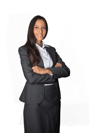 observant: Smiling young Asian businesswoman in a stylish grey suit standing with folded arms looking at the camera, conceptual of authority and leadership, isolated on white