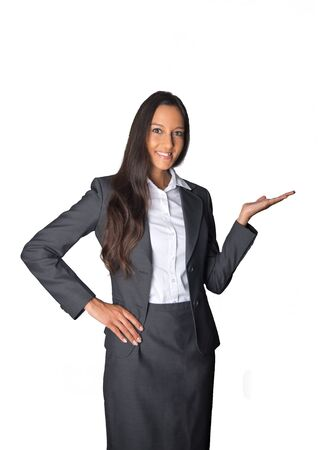 product placement: Stylish Asian businesswoman standing holding out her empty palm for product placement, in welcome, or displaying something, isolated on white Stock Photo
