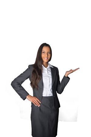 saleslady: Stylish Asian businesswoman standing holding out her empty palm for product placement, in welcome, or displaying something, isolated on white Stock Photo