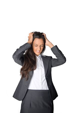 expressing: Upset emotional stylish young Asian businesswoman standing tearing at her hair in frustration and grimacing in anger, isolated on white Stock Photo