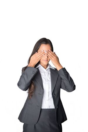 visualise: Serious young businesswoman blocking her eyes with her hands as she tries to visualise a new idea or concept, isolated on white