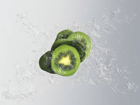 pip: Fresh exotic kiwi fruit with a splash effect and bubbles showing a sliced fruit with pip detail in clear clean water over a graduated grey background