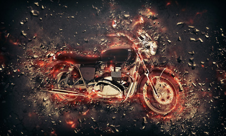 extreme danger: Fiery burning motorbike conceptual image with flames erupting from the wheels and frame depicting extreme sport, speed and danger over a dark background