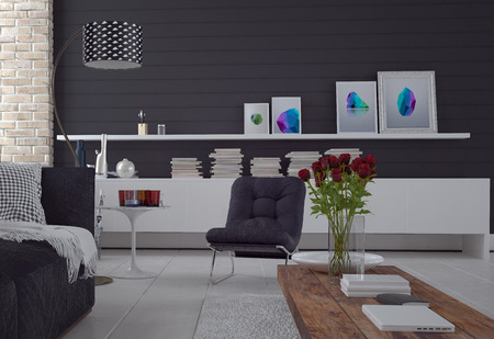 Comfortable simple black and white living room interior with a sofa, chair, cabinet with books and art, and red roses in a vase on a coffee table Zdjęcie Seryjne