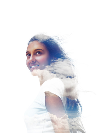 Smiling Young Asian Indian Woman Portrait and Clouds in a Double Exposure Effect on a White Background.