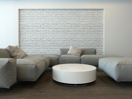 Rustige moderne grijze woonkamer interieur met comfortabele hoek banken, een ronde witte tafel en getextureerde functie bakstenen muur