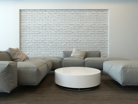 living room furniture: Tranquil modern grey living room interior with comfortable corner couches, a round white table and textured feature brick wall