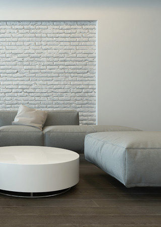 living room minimalist: Tranquil modern grey living room interior with comfortable corner couches, a round white table and textured feature brick wall