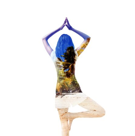 woman posture: Artistic double exposure of a woman doing yoga balancing on one leg with her arms raised overlaid with trees and nature, over white