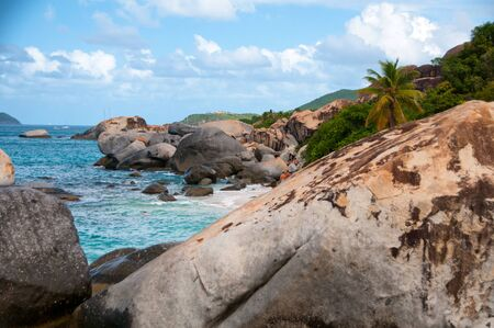 Tranquil View of The Baths in Beautiful Virgin Gorda Island in Caribbean, Emphasizing Huge Rocks on the Side of Turquoise Sea Water. Stock Photo
